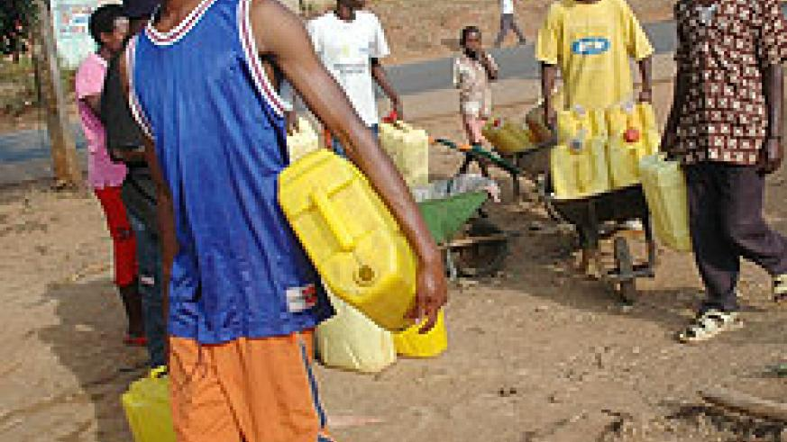 Kigali residents trekking for water. Water crisis has been reported in hilly parts of the city (File Photo)