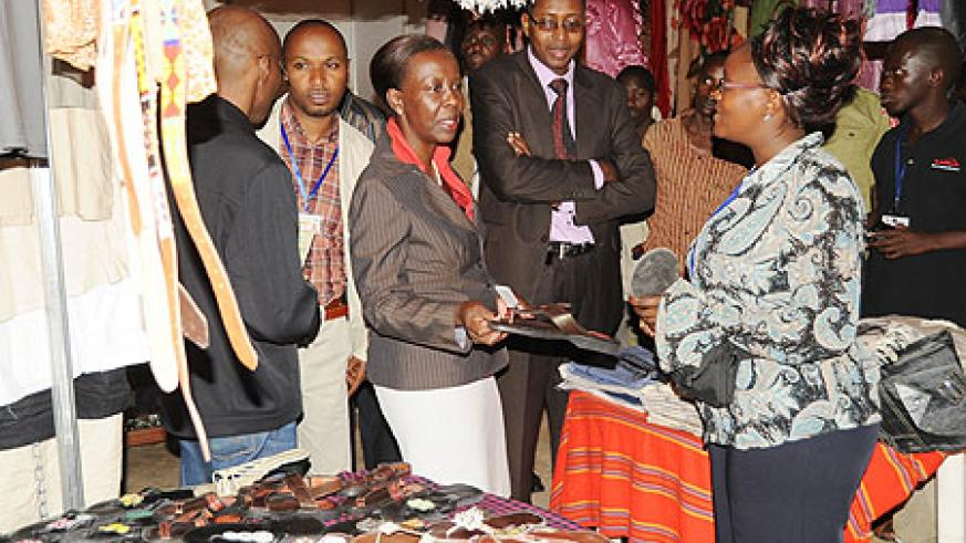 Foreign Affairs Minister Louise Mushikiwabo (C) visits one of the Stalls at the Diaspora Expo. (Photo J Mbanda)