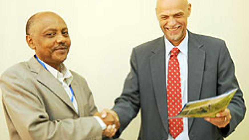 RARDA's Dr. Theogene Rutagwenda with Jan Delbaere of WFP after the signing yesterday (Photo / T. Kisambira)