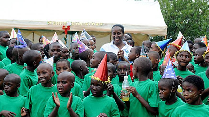 The First Lady, Jeannette Kagame, sarrounded by the Children at the Christmas party, yesterday. (Photo Village Urugwiro)