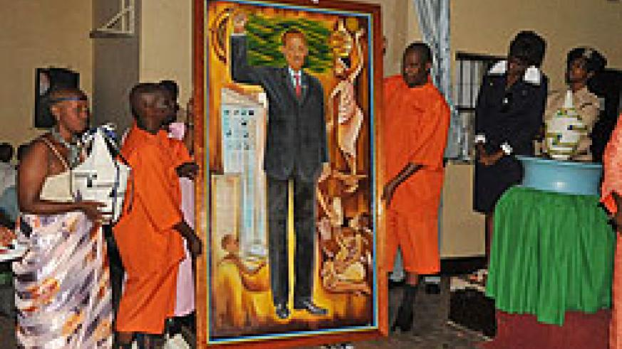 Inmates at 1930 displaying a painting they made of President Paul Kagame at the event yesterday (Photo / S. Mugisha)