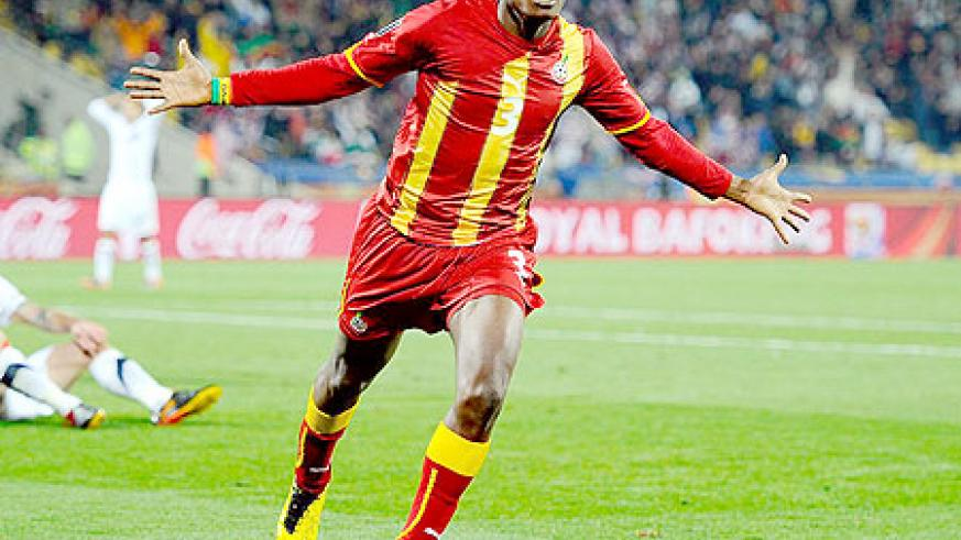 For Africa! Asamoah Gyan celebrates scoring Ghana's extra-time winning goal to the delight of a continent.