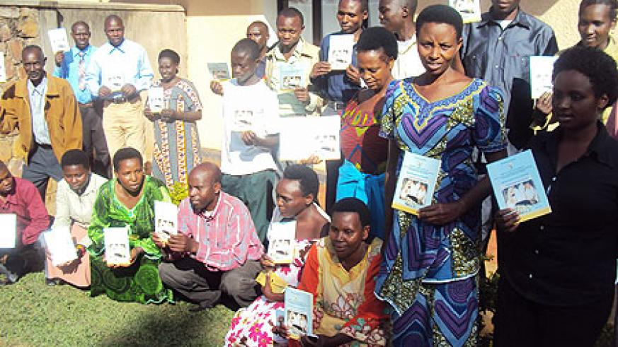 Poultry farmers pose for a photo after the training. (Photo by S. Rwembeho).