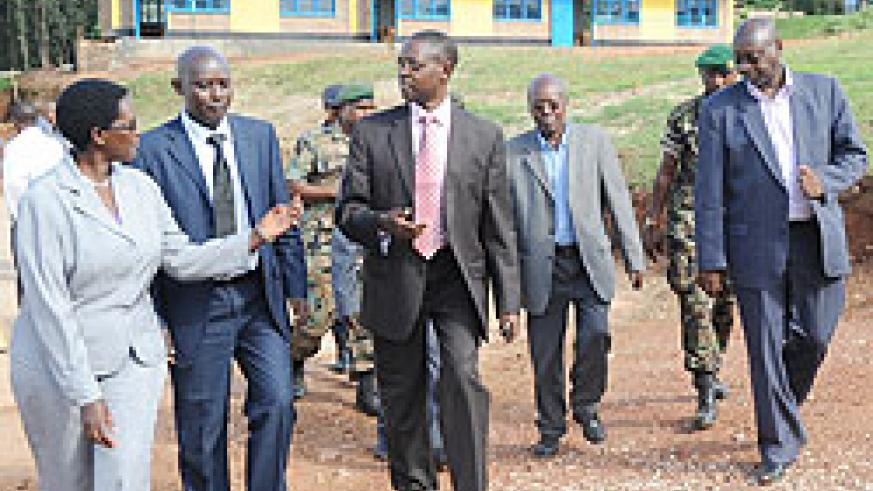 State Minister Mathias Harebamungu and Local leaders tour Kagarama primary school in Kicukiro District. 9-YBE  was priority in 2010 (File photo)
