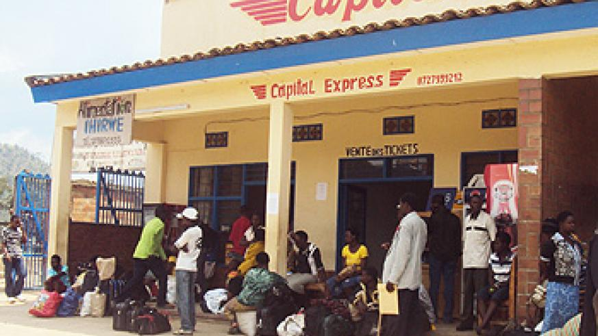 Stranded passengers at one of the bus terminals in Karongi town yesterday (photo S Nkurunziza)