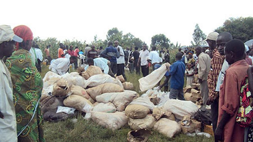 Residents gathering around smuggled illicit brew before the contraband was destroyed
