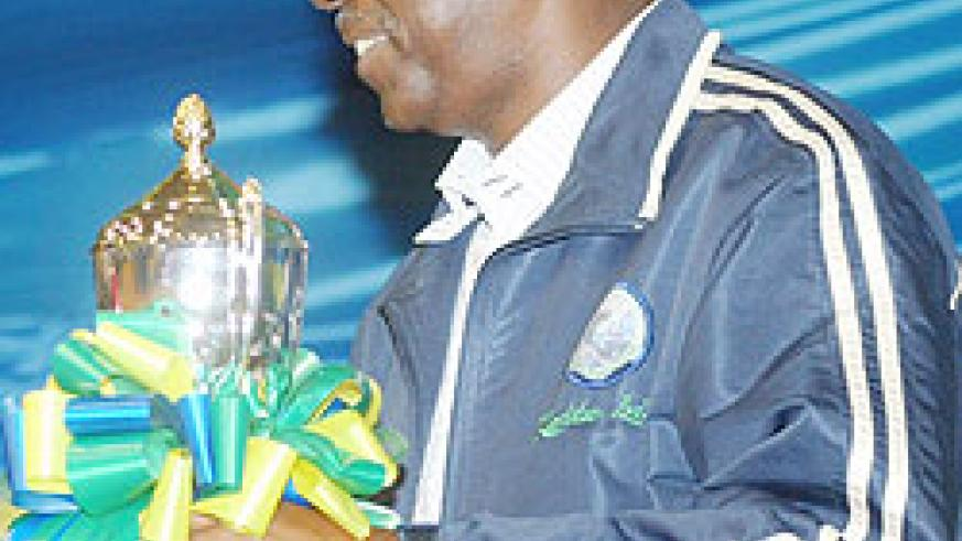Prime Minister Bernard Makuza with the runners-up trophy  of the 2008 Zone 5 basketball championship. He has backed Rwanda's bid to host the African Cup of Nations. (File photo)