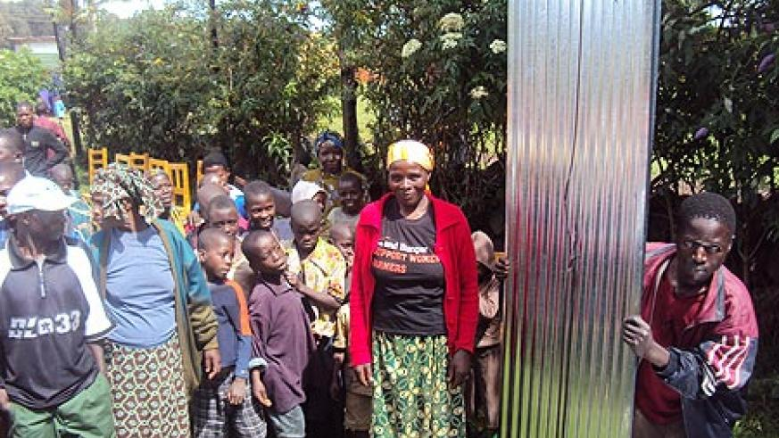 Some of the beneficiaries receiving the iron sheets in Shingiro sector (Photo B. Mukombozi)