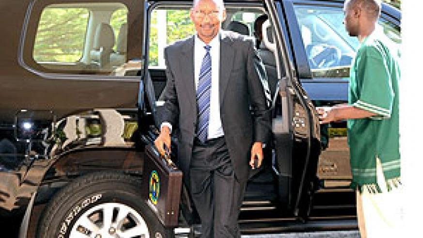 Minister John Rwangombwa heads to the Parliament to present the FY 2010-11 Budget (File photo)
