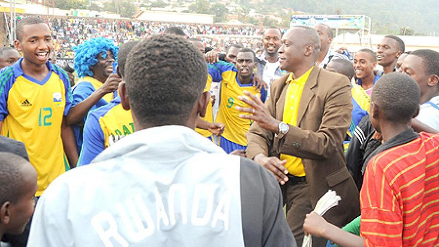 Sports minister Joseph Habineza can't hide his excitement after Tuesday's game were the junior wasps edged Egypt 1-0 to qualify for the 2011 Fifa U-17 World Cup. (Photo. T. Kisambira)