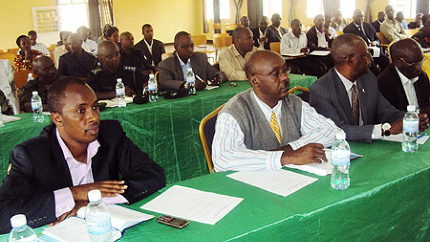 MPs (Front row) during the performence contracts presentations. Photo S. Rwembeho.