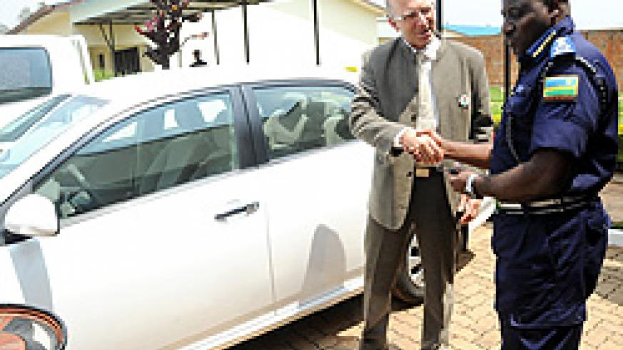 BTC Resident Representative, Jean Yves Saliez (L), handing over the Vehicles to Commissioner General of Police, Emmanuel Gasana. (Photo J Mbanda)