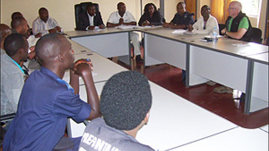 JRS Country Director Gerard Clarke (extreme right) in a meeting with District authorities prior to throwing out journalists. (Photo / A. Gahene)