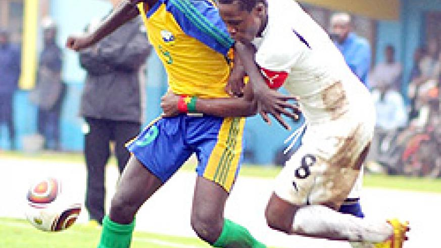 Junior wasps midfielder Eric Nsabimana hands off a Burkina Faso player.  The West Africans lost the tie 1-2.(Photo / T. Kisambira)