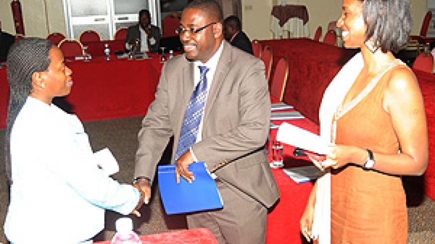 Minister of Trade and Industry Monique Nsanzabaganwa (L) greets Dr.Andrew Seguya as RDB's Rica Rwigamba looks on. (Photo J Mbanda)