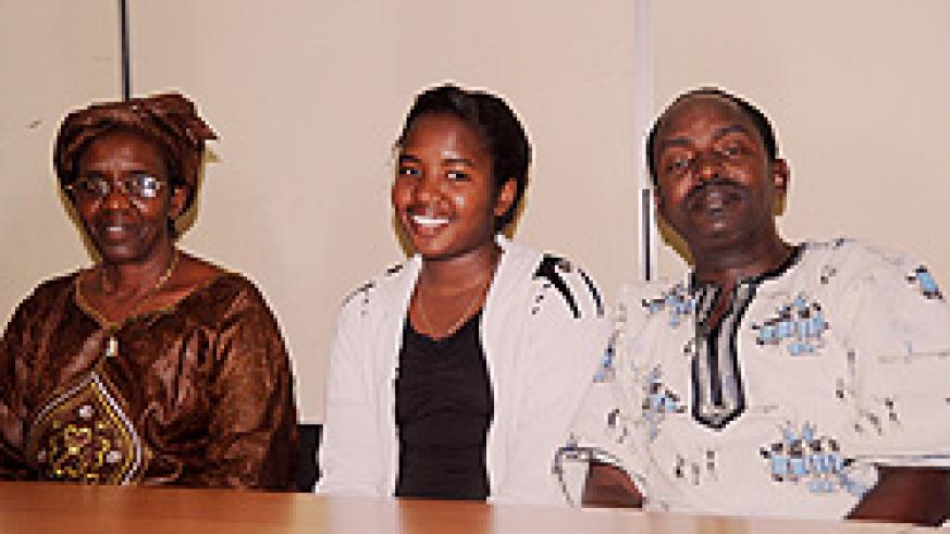 Diana Munyana Musoni (C) the best student in O-level with her parents, yesterday (Photo T.Kisambira)