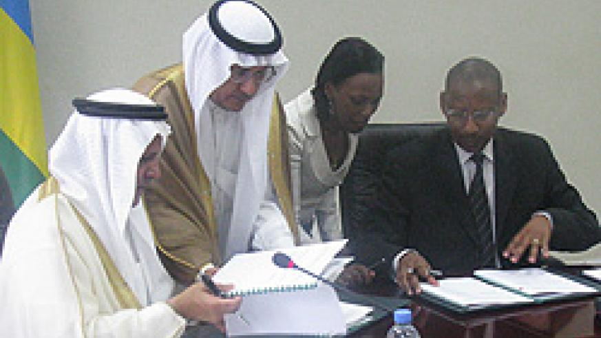 The Vice Chairman and Managing Director of Saudi Fund for Development Eng. Yousef Ibn Ibrahim Al-Bassam (L) and the Minister of Finance, John Rwangombwa (R) signing the loan agreements