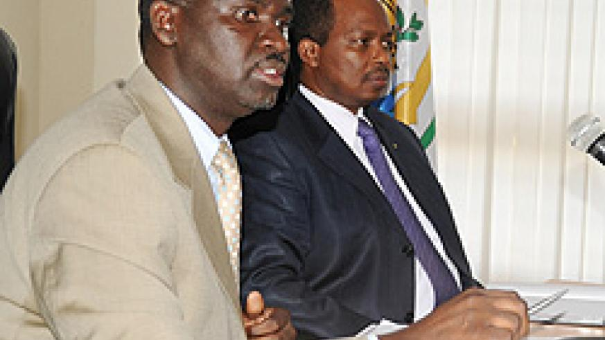 Minister Stanislas Kamanzi of Environment and Lands emphasises a point as Infrastructure's Vincent Karega looks on (Photo T Kisambira)
