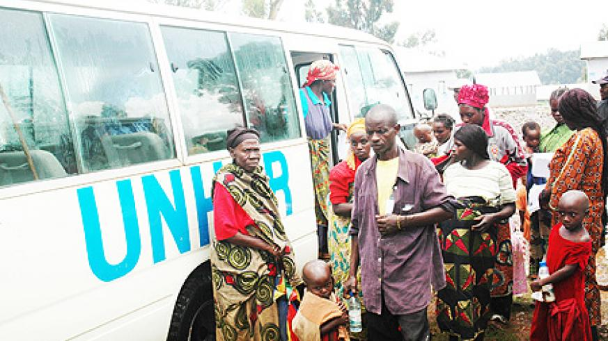 Returnees from DRC disembark from a UNHCR van. Government has launched another campaign to repatriate refugees (File Photo)