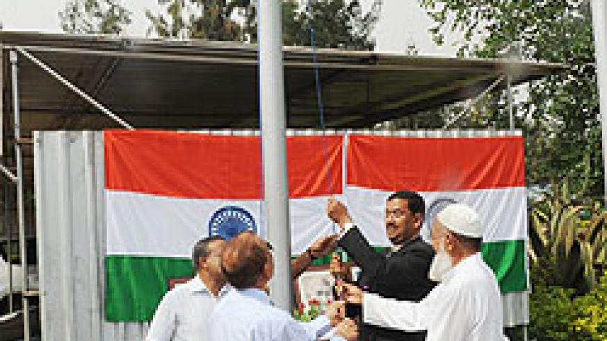 Indians hoisting their flag during the celebration of the India Republic Day yesterday (photo T Kisambira)