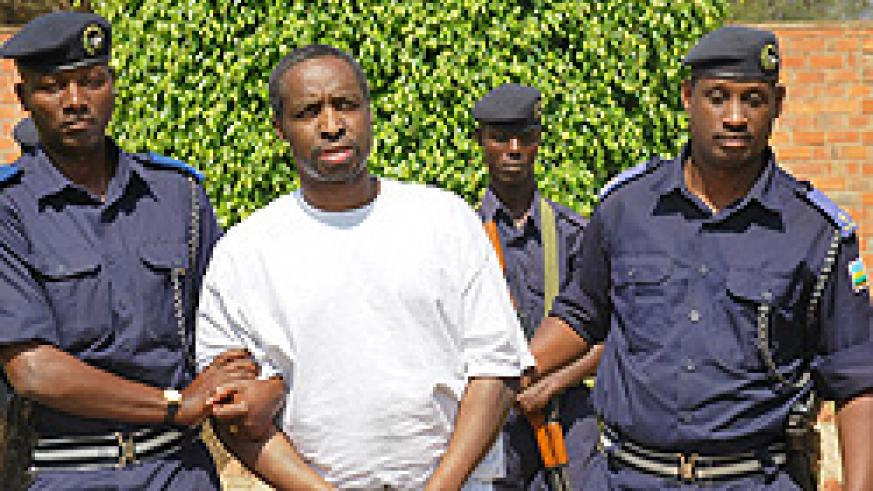 Jean Marie Vianney Mudahinyuka is led to detention by police officers following his deportation yesterday (Courtsey Photo)