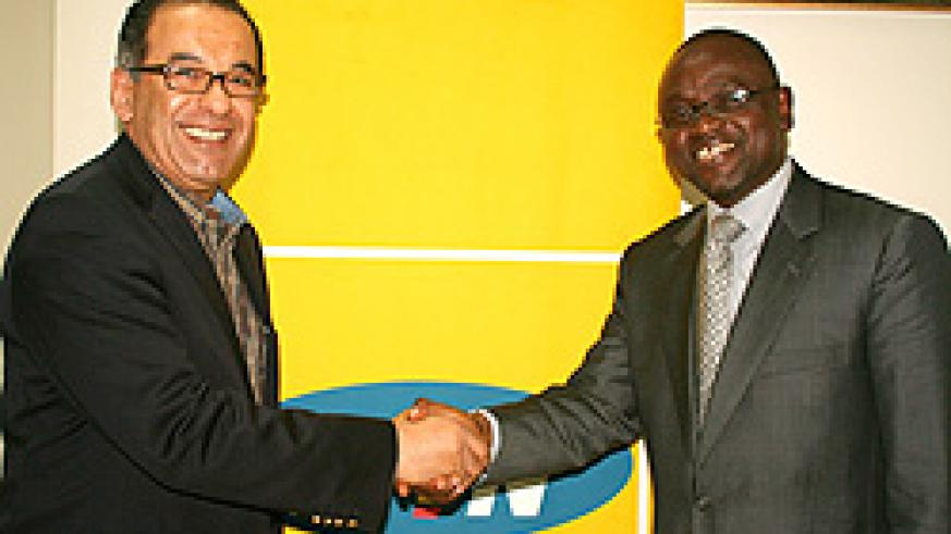 MTN CEO Khaled Mikkawi and ACBF'S Bakary Kone after meeting at MTN Centre on Thursday (Photo E Kabeera)
