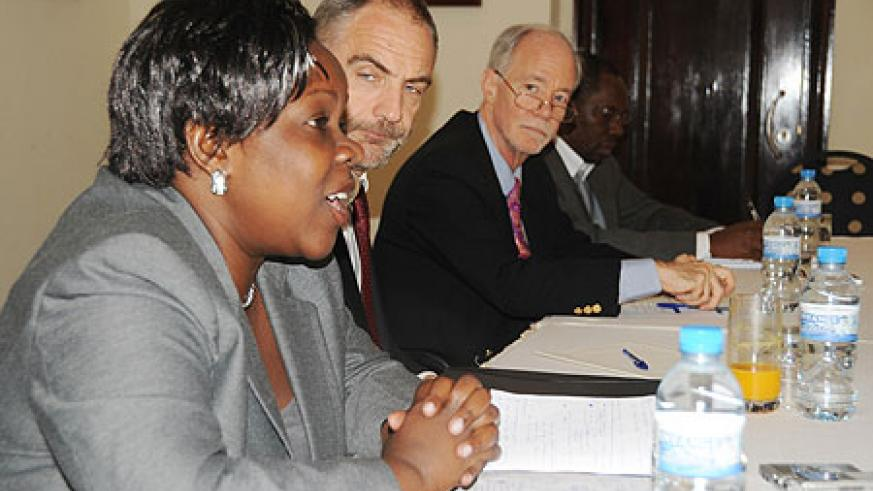 (L-R) Edith Ofwono- Adera, Senior IDRC programme  specialist, Dr Simon Carter, Regional Director of IDRC, and David Malone, the IDRC  president at (photo T.Kisambira)