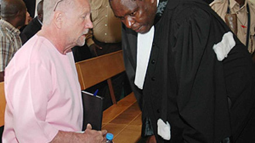 Peter Erlinder consults with his lawyer during one of the bail hearings last year (File Photo)