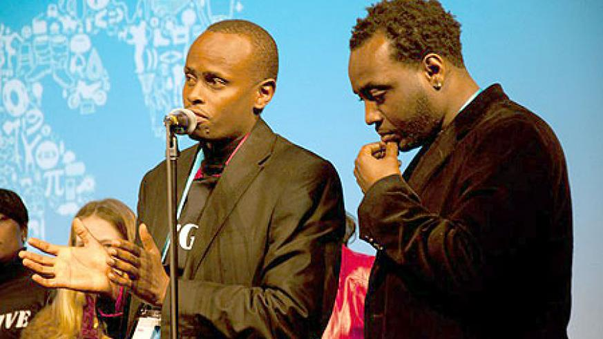 From (l-r), the Executive Producer of Kinyarwanda, Ishmael Ntihabose speaking at the event, looking on is the author/producer of the movie, Alrick Brown (courtesy photo).