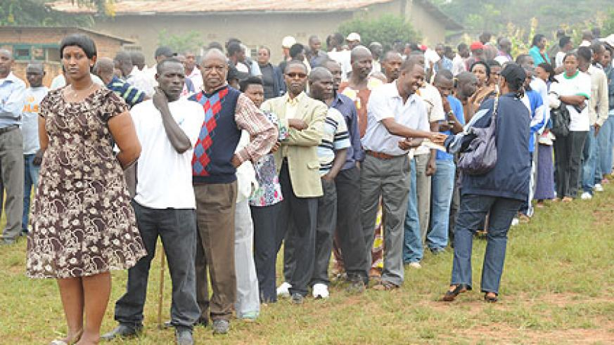 Voters line up behind their candaidate during the local government elections yesterday (Photo- T. Kisambira)