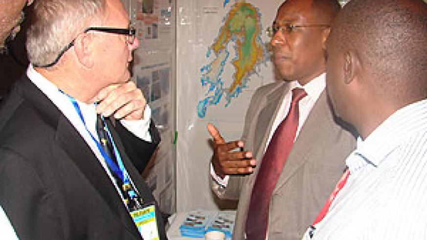 Yussuf Uwamahoro the energy sector coordinator in MININFRA speaks to one of the investors during the Petroleum Conference yesterday. (G Muramira)