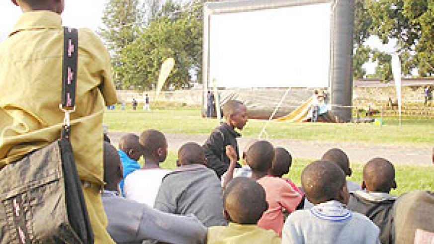 A crowd in rural Rwanda waits anxiously to watch a film on one of Hillywoods inflatable screens. (File Photo).