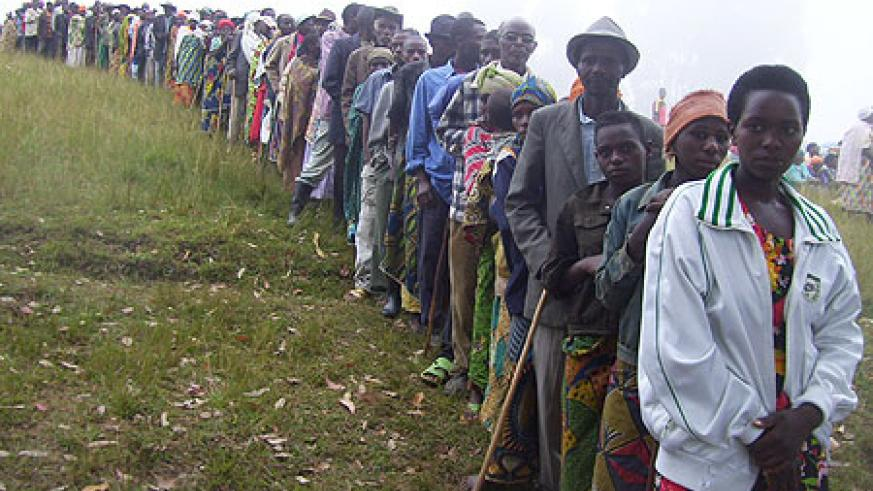Residents line up to elect village cell advisory council representatives at Ngondore cell site yesterday (Photo by A.Gahene)