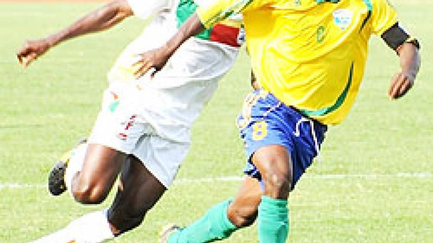 Haruna Niyonzima (R) in action against Benin. (File Photo)