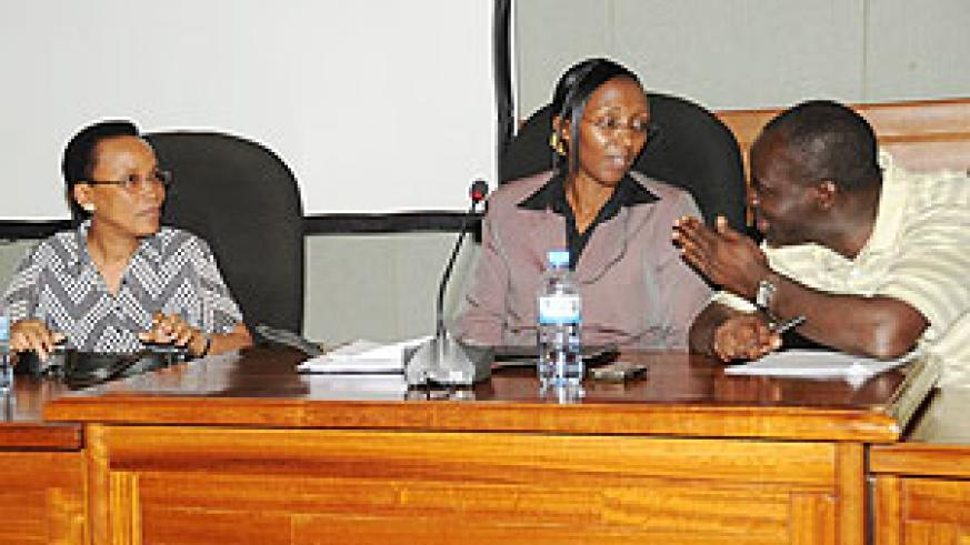 Ministers Stanislas Kamanzi of Environment (R) and Coletha Ruhamya of Water and Energy (c) with REMA Director General, Rose Mukankomeje, during the meeting, yesterday. (Photo J Mbanda)