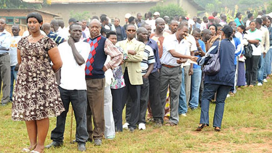Voters line up behind their candidates during last week local government elections (File Photo)