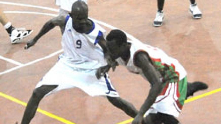 Rwanda's point guard Aboubacar Barame tries to defend against Burundi yesterday. Although he didnot get on the score sheet, he still had a good game. (Photo / J. Mbanda)