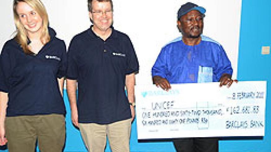 Jennifer Ollerenshaw and Nick Salisbury from Barclays Bank after presenting the dummy cheque to Dr Joseph Foumbi (Photo T.Kisambira)