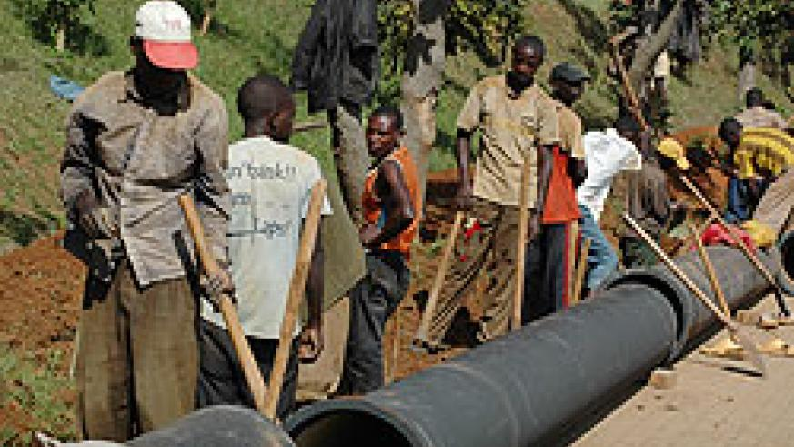 People working on laying a water pipe in Kigali City. RWASCO has invested heavily in the project (File Photo)