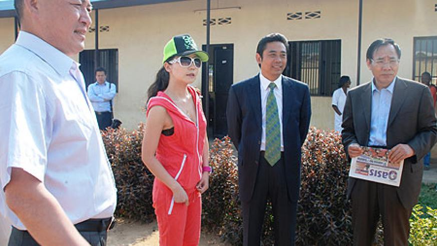 The chairman of World Eminence Chinese Business Association Junqing Lu(Second right) during a tour of Kagugu school (courtesy photo)