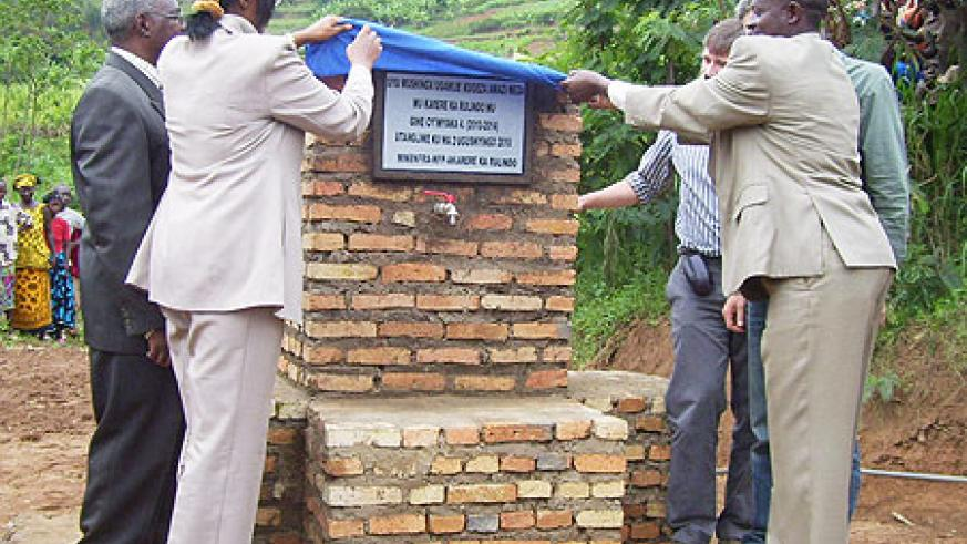 Mayor Kangwagye and Ministers Ruhamya and Gen.Gatsinzi during the  launch of a  water project at Kajevuba cell. File  Photo