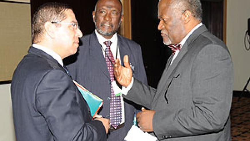 PALU President Akere Muna (R) chats with Hashim Abubaker (C) and another delegate chat during the meeting on Saturday. (Photo J Mbanda)