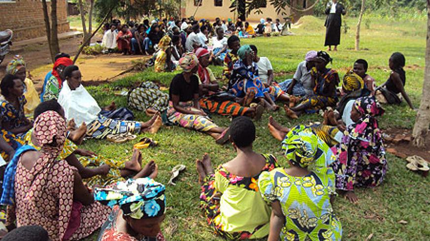 Women listen to electoral guidelines from NEC officials.(Photo S. Rwembeho)
