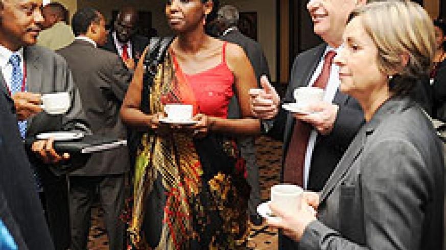 Minister of Agriculture Agnes Karibata (C) with Dr. Bernard Vallat (2nd right) and dr. Theogene Rutagwenda (L) at the conference. (Photo J Mbanda)