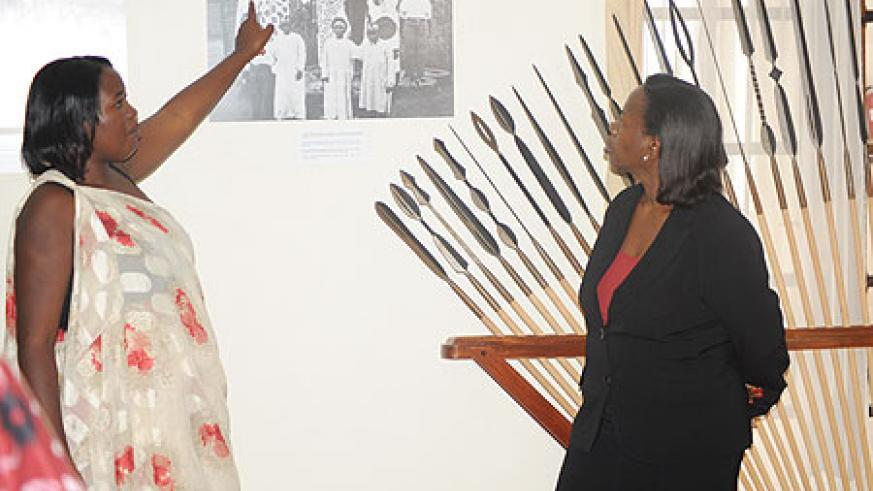 Minister Nsanzabaganwa being taken on guided  tour of the Huye museum by an official of the insitution (Photo J P Bucyensenge)