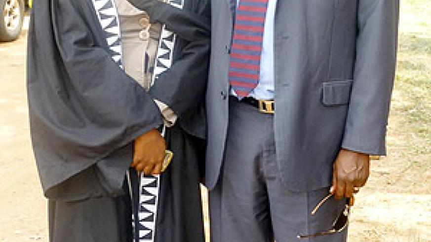 Charity Karungi (L) with a cousin brother on graduation day.