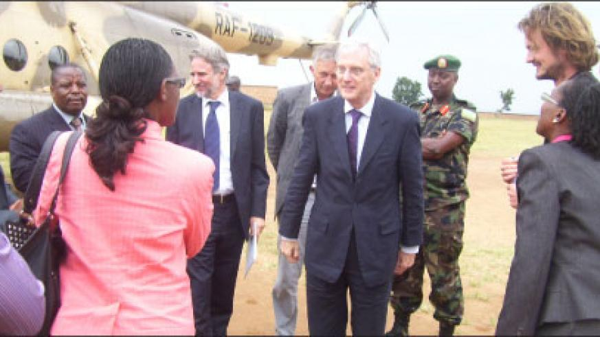 The visiting Dutch Minister, Dr. Ben Knapen, chats with community leaders from Gicumbi district during his tour of the Dutch funded projects in the Northern Province on Wednesday.(File Photo)