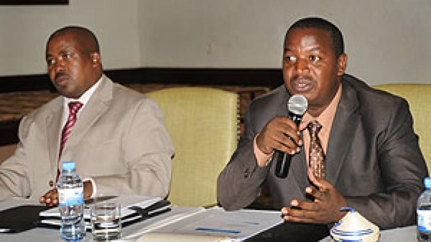 Permanent Secretary in MINALOC, Cyril Turatsinze (R), speaking at the meeting. Left is Director General in the Ministry, Egide Rugamba. (Photo J Mbanda)