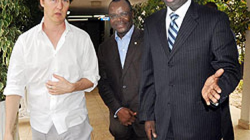 UN Goodwill Ambassador for Biodiversity, Edward Norton (L), with Land and Environment Minister, Stanislas Kamanzi (R) and UN resident Coordinator, Aurelien Agbenonci, after meeting the Prime Minister. (Photo J Mbanda)