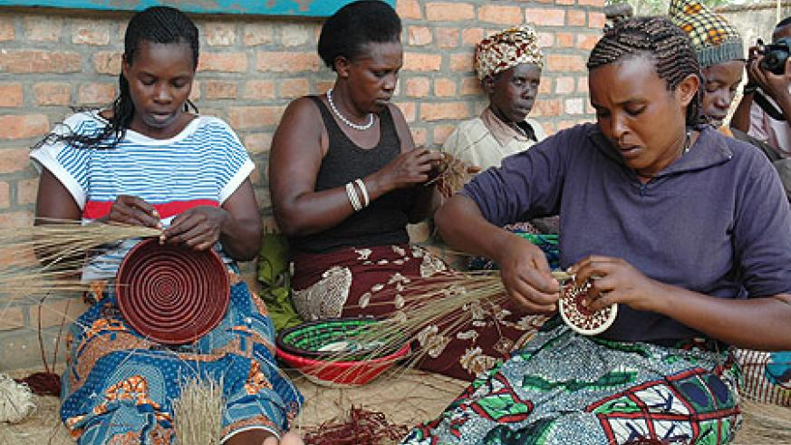 Women weaving Agaseke. Financial independence will curtail GBV (File Photo)